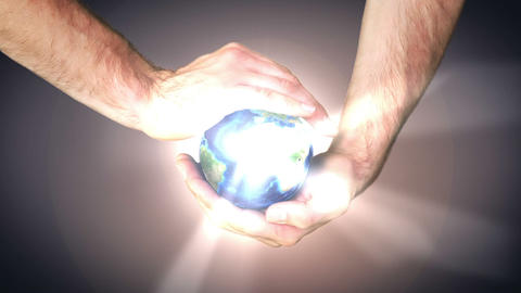 Earth spinning in mans hands Stock Video Footage