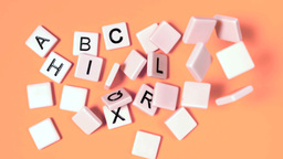 Plastic letters bouncing and showing alphabet on o Footage