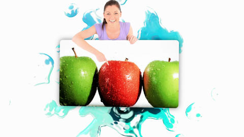 Smiling woman holding a poster of fruits falling into water Animation