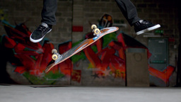 Close up of skater doing double flip trick Footage