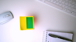 Yellow post it with chroma key falling on office desk Footage