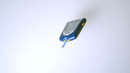 Blood glucose monitor falling on white surface Footage
