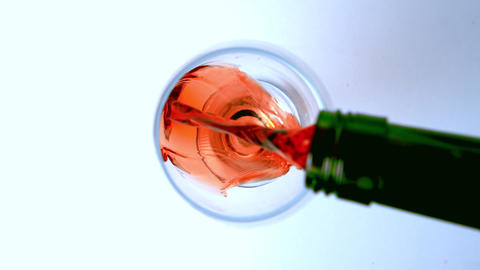 Overhead Shot Of Red Wine Being Poured Into Glass stock footage