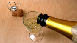 High angle view of champagne being poured into flu Footage