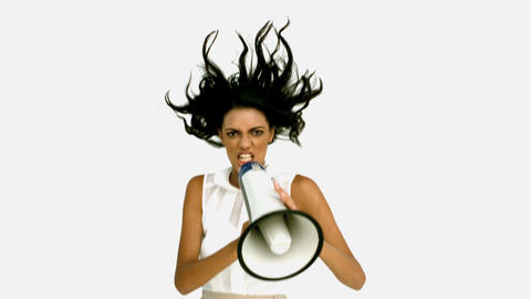 Angry businesswoman shouting on megaphone and jump Footage