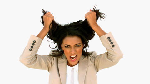 Stressed businesswoman shaking her hair Footage