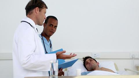 Doctor speaking to patient Footage