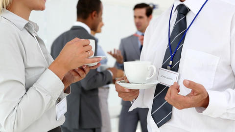 Business people chatting during coffee break Footage