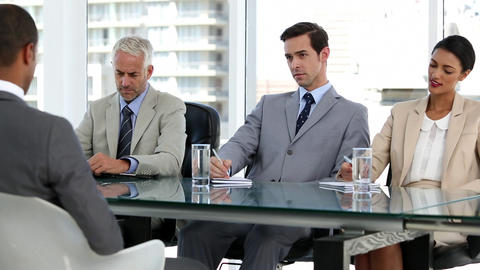 Business people interviewing a candidate Footage