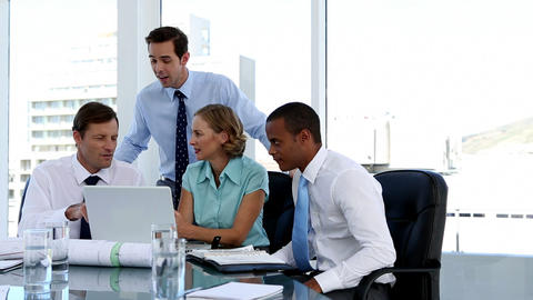 Business people using a laptop during meeting Live Action