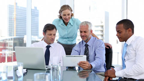 Group of business people using laptop and tablet c Footage