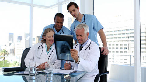 Group of doctors examining an xray together Footage