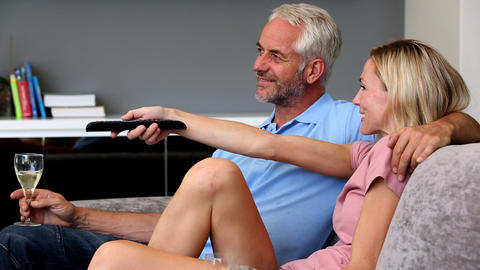 Mature couple watching television in the living ro Footage