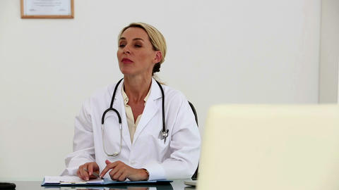 Female doctor asks a patient to sit down Footage