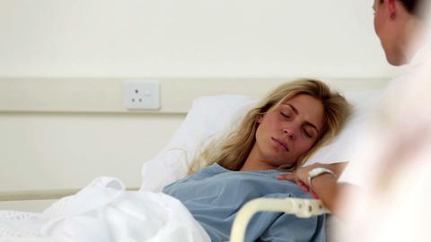Nurse comforting unwell patient Live Action