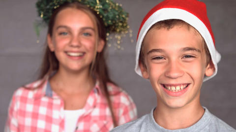 Smiling siblings with christmas hat Footage