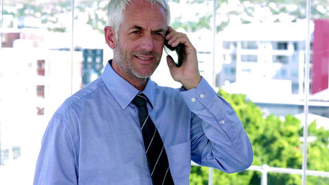 Businessman answering his phone and looking impressed ライブ動画