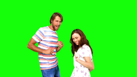 Two friends dancing together on green screen Footage