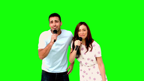 Friends dancing and singing on green screen Footage