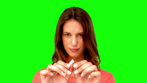 Brunette woman breaking a cigarette Footage