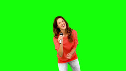 Young woman singing in microphone Footage