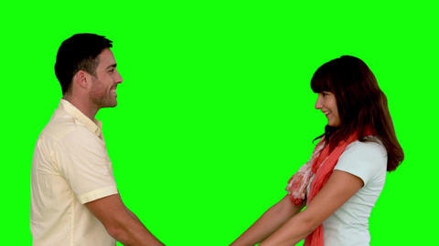 Young couple cuddling on green screen Footage