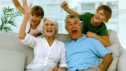 Grandparents and children raising their arms in th Footage