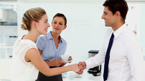 Business people shaking hands at break time Footage