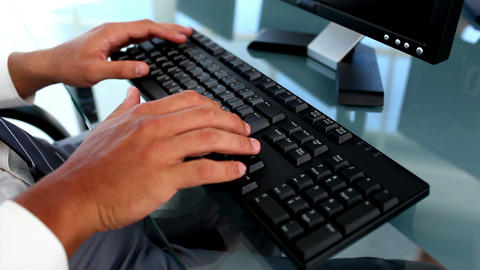 Hands typing on a keyboard Footage