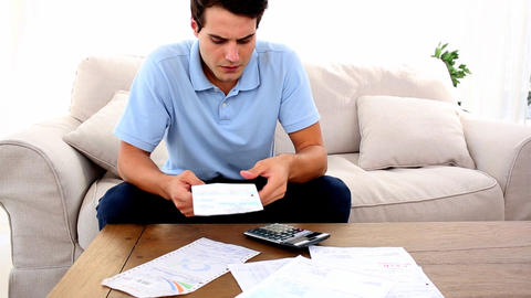 Man stressed with so many bills to pay Footage