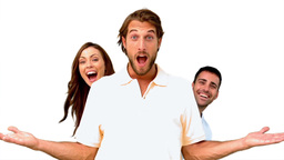 Friends hiding behind a man on white background Footage