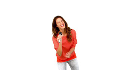 Young woman singing in microphone against white ba Footage