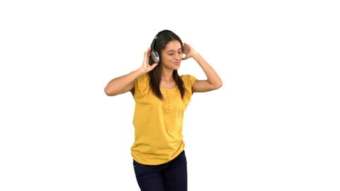 Woman dancing with headphones on white background Footage