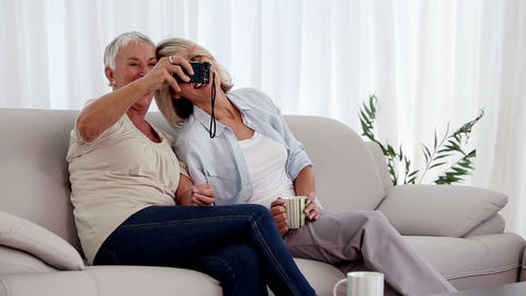 Mature women taking a picture together Footage