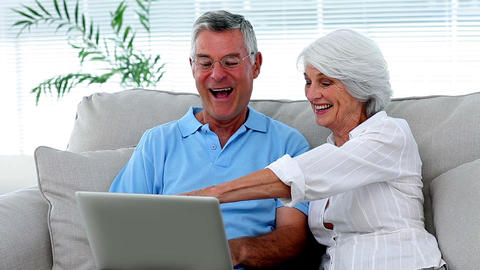 Retired couple using laptop together Footage