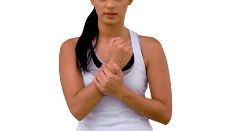 Fit woman massaging her sore wrist Footage