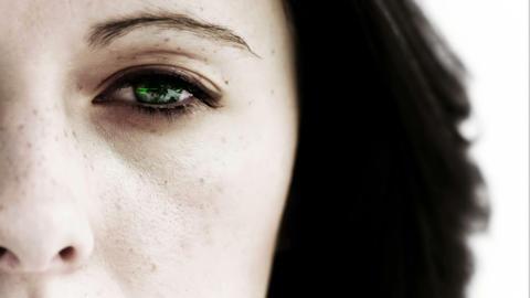 Girl opening her eye to reveal green scrolling data CG動画