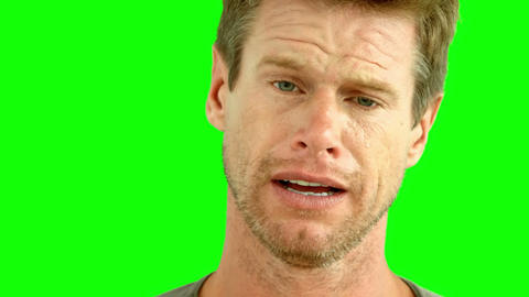 Man crying on green screen Footage