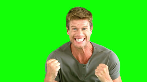 Man showing his happiness on green screen Footage