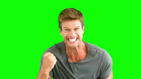 Attractive man gesturing and showing his happiness Footage