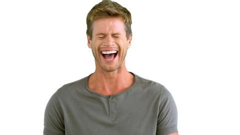 Man laughing on white background Live Action