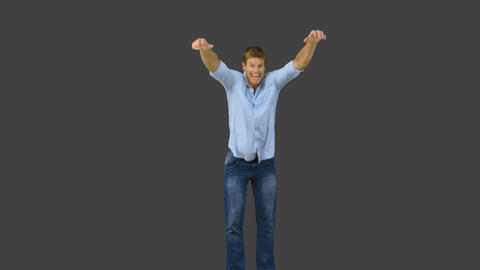 Man jumping to show his triumph on grey screen Footage