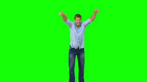 Man jumping to show his triumph on green screen Footage