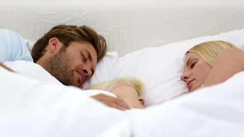 Parents and daughter sleeping together Footage