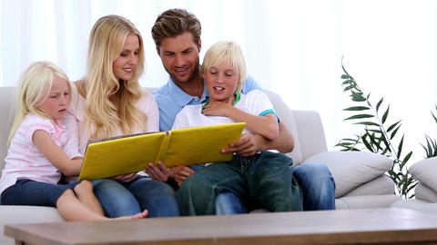 Family reading storybook together Footage