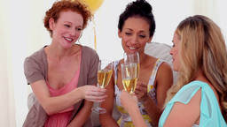 Friends toasting with champagne at a party Footage