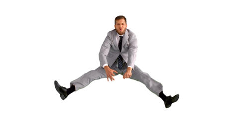 Businessman jumping and doing the splits Footage