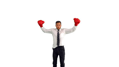 Businessman in boxing gloves jumping and punching  Footage