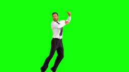 Businessman jumping and giving thumbs up Footage