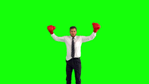 Businessman leaping with boxing gloves and hitting Footage